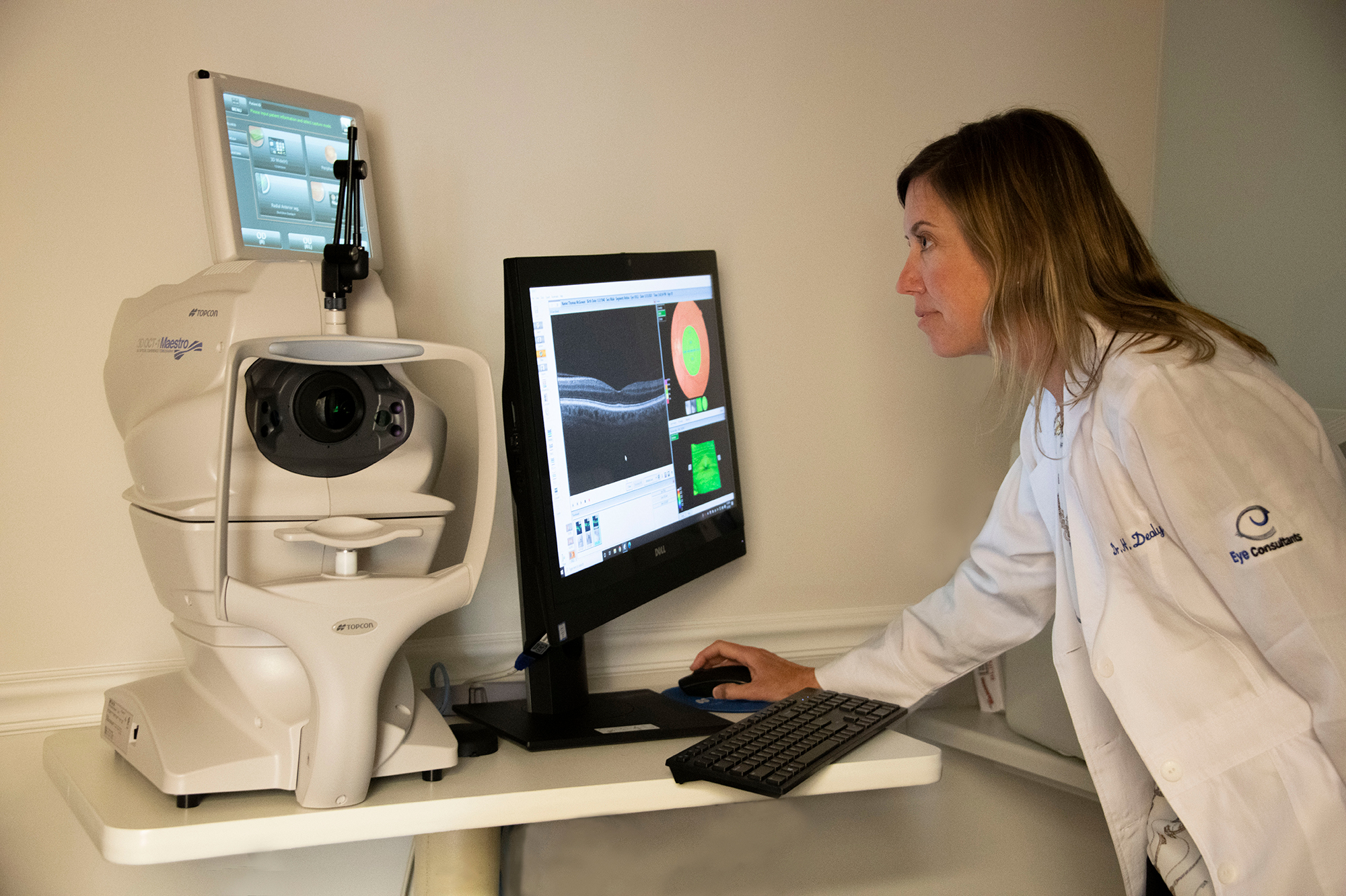 Dr. Dealy checking scans of eye for cataracts